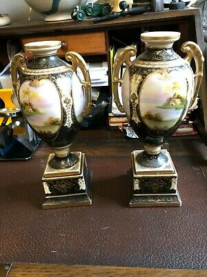 A pair of hand painted 19th/20th Century Porcelain Urns