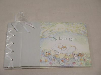 My Little One  photo album Becky Kelly holds 22 4X6 photos