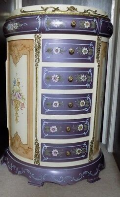 A reproduction French Louis XV cream bow print chest of drawers