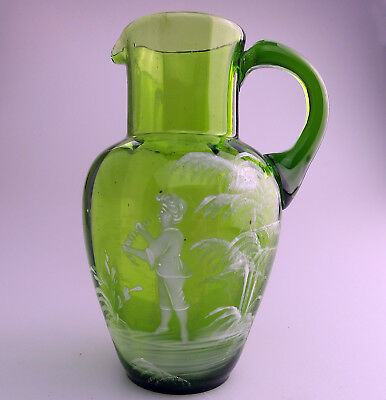 Antique Victorian Coloured Glass A green Mary Gregory boy h/enamel Jug C.19thC