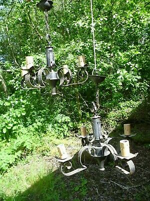 A Vintage Pair Of French Medieval Look, Four Armed Wrought Iron Chandeliers