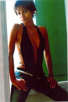 Halle Berry - In Jeans And A Halter Top - Sitting On A Window Ledge !!!