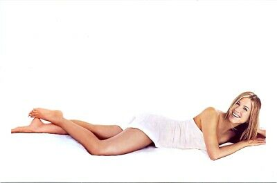Jennifer Aniston - Lying On Her Tummy In A White Dress - Sexy Pic !!!