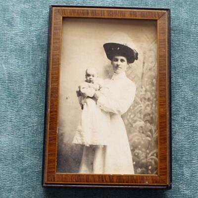 Framed Portrait of Elegant Mother in Ostrich Feather Hat Holding Her Baby