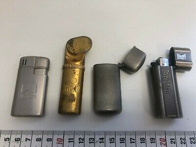 Two vintage lighters and two vintage lighter holders. Blend and Marlboro.