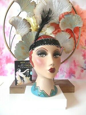 Flapper  style hand painted mannequin head.