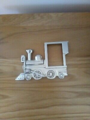 Small white metal photo frame in the shape of a steam engine