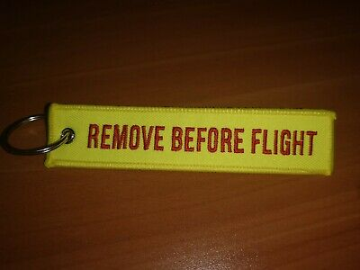 Llavero Remove Before Flight amarillo yellowENVÍO GRATIS DESDE ESPAÑA EN 24HORAS