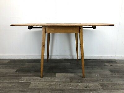 Early Ercol Windsor dropleaf dining table, blonde elm
