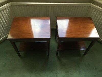 Matching pair of mahogany tiered side tables