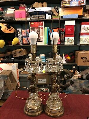 Beautiful Pair Of Antique Ornate Figural Cherub Lamps with Solid Crystal Bases.