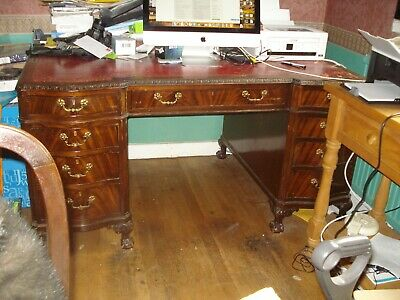 A mahogany twin­pedestal desk in George II style