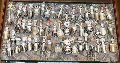 Job lot of vintage silver plated souvenir tea caddy spoons, enamel badge