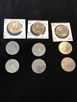 Lot Of 9 - Canada 1977 Dollars, Inc 1 With Green Stone Glued On It, See Pics