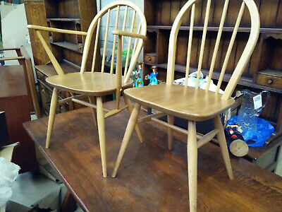 Two Ercol Elm And Beech Windsor chairs In Light Finish One Of Which Is Carver