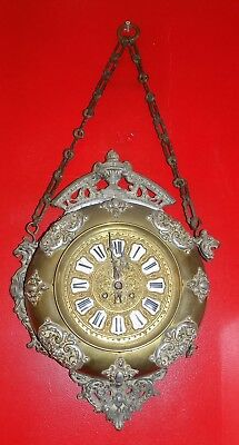 A 19th century brass and pewter cased circular wall clock
