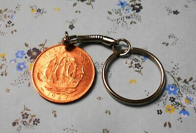 Half-Penny coin attached to a keychain for the year of 1967