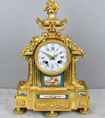 Antique French ormolu and porcelain panels clock by Louis Constantin Detouche.