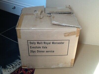 A boxed set of 20 pieces of Royal Worcester Evesham Vale porcelain table ware