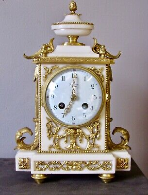 French Ormolu and marble mantle clock retailed be Asprey London.