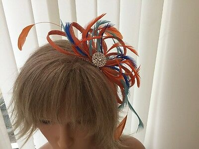 Orange , Turquoise And Cobalt  Sinamay/ Feather Fascinator  Can Be Custom Made
