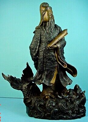 19th CENTURY CHINESE BRONZE DAOIST IMMORTAL 'STANDING ON DRAGON FISH' SCULPTURE