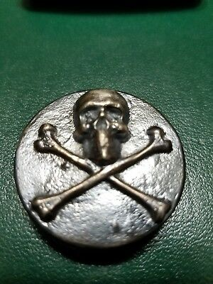 2.00 Troy oz Hand poured 99.9% Silver. Skull pirate coin round.antiqued.