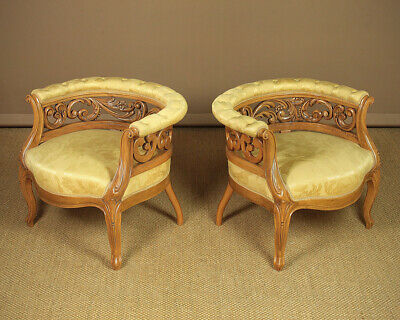 Pair of Low Upholstered Beechwood Armchairs.