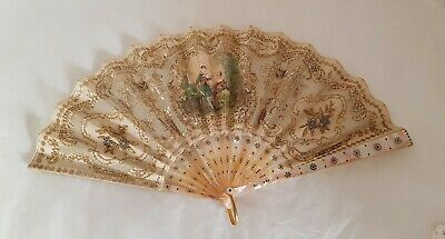 An antique European hand held fan. Green snail shell guards, inlaid with rondels