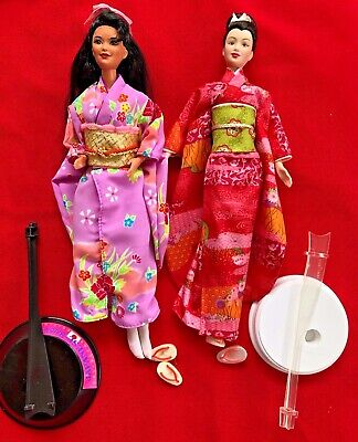 Two beautiful Mattel DOTW Japanese Barbies, w/stands