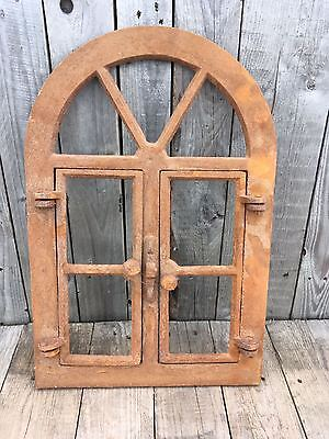 Industrial Cast iron arched window frame An Arch Cast Iron Rusty Window