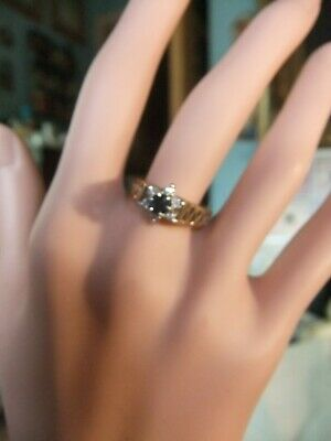 heavy 9ct gold engagement ring with central sappire & 6 diamonds size Q
