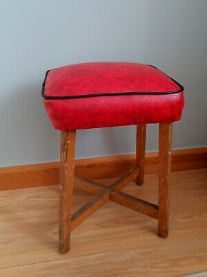 Vintage, retro red  leather stool with cross legs