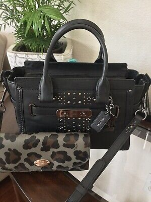NWT COACH BLACK LEATHER SWAGGER CLUTCH with BANDANA RIVETS