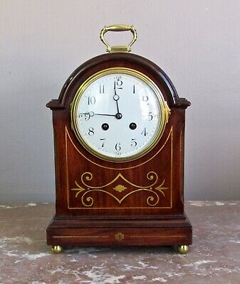 Antique French  mahogany and brass inlay mantle bracket style clock. Circa 1910