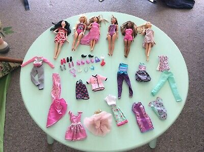 Bulk Lot of Barbie Dolls, Clothes, Shoes and accessories