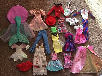 Bundle of assorted Barbie & Fashion doll clothes: dresses, trousers, mermaid ++