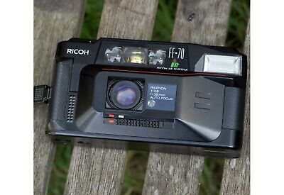 Ricoh FF 70 35mm point and shoot film camera. Good condition.