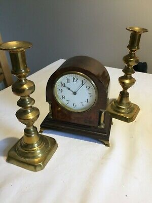 Antique mantle clock and 2 brass candle holders