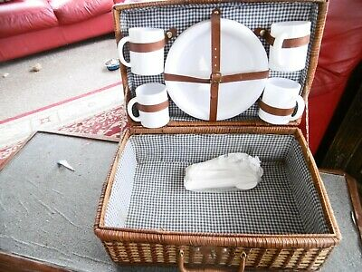 Clean wicker picnic basket including 4 mugs and 4 plates with assorted cutlery