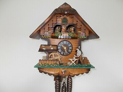 Woodcutter Chalet Musical Cuckoo Clock...with lots happening!