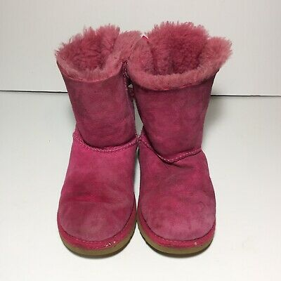 f39a281005a UGG GIRLS' MINI Bailey Bow Flowers, Baby Pink Suede & Shearling ...