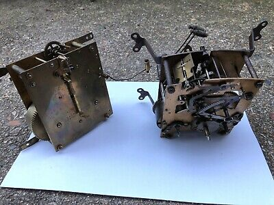 2 vintage Enfield and D.R.G.M clock mechanisms for spare  / repair.