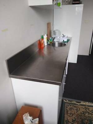 Stainless Steel Kitchen Bench top and White Cabinetry