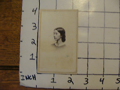 photo of a ladies head  with tax stamp on back,