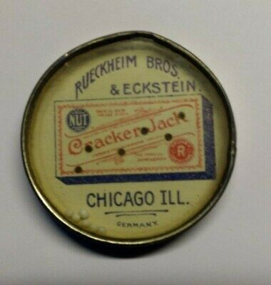 Cracker Jack Dexterity Game with graphic old celluloid pocket mirror advertising