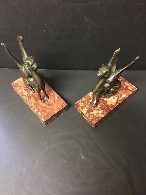 A pair of 19th Century French Empire period Egyptian revival bronze winged griff