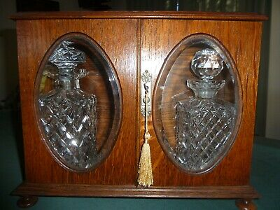 TANTALUS - ANTIQUE SOLID TIMBER with TWO CRYSTAL DECANTERS