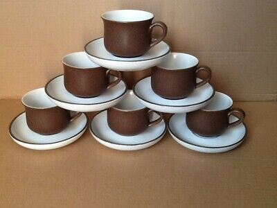 A set of 6 Denby stoneware tea cups and saucers