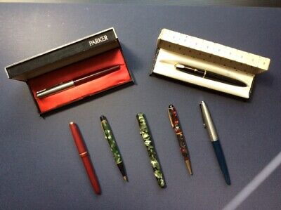Collection of vintage fountain pens and propelling pencil